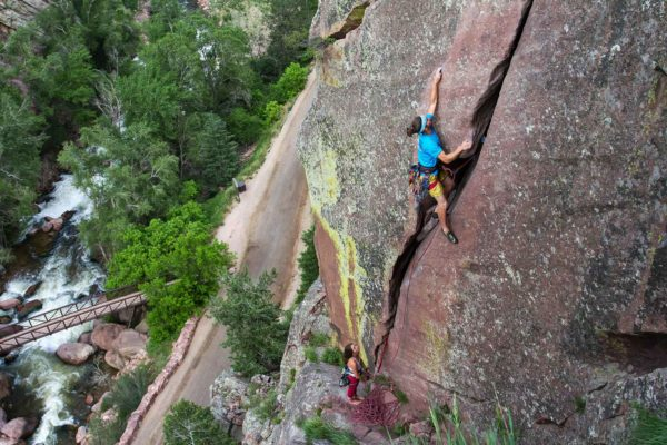 Ian King on Werk Supp (5.9) in Eldorado Canyon, CO. Photo by Kevin Riley.